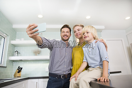 father taking selfie with his family