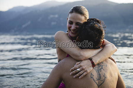 happy young couple hugging in a
