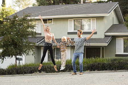 happy family with son jumping in