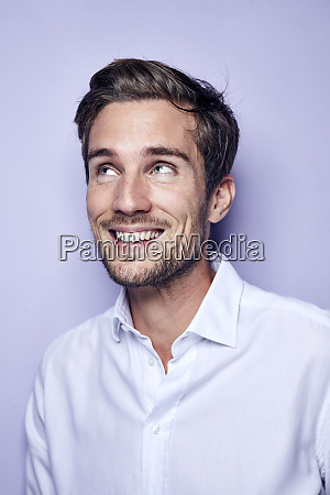 portrait of laughing young man in