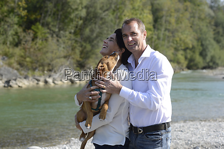mature couple with a dog at