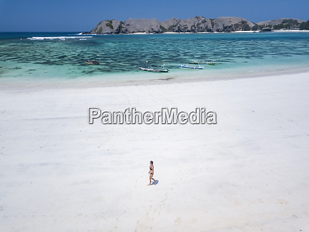 indonesia lombok young woman beach stroll