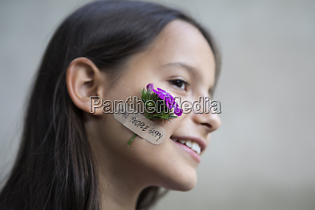 portrait of smiling girl with flower