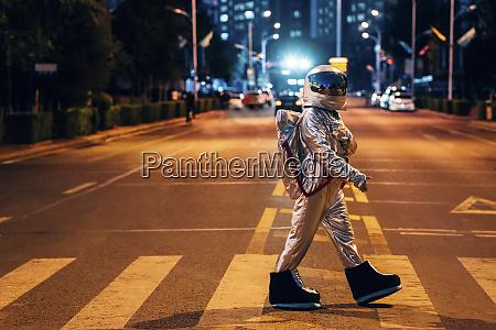 spaceman walking on a street in