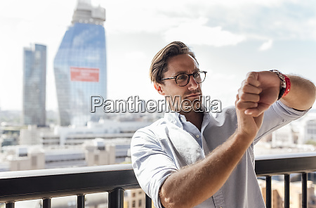 uk london man using smartwatch on