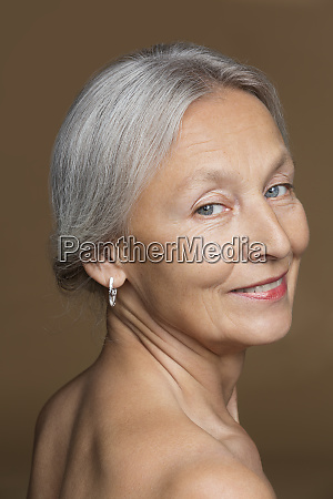 portrait of naked senior woman with