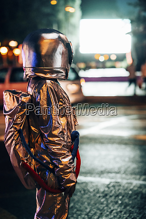 spaceman on a street in the