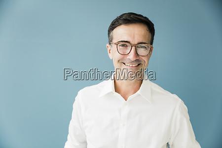 portrait of smiling businessman wearing glasses
