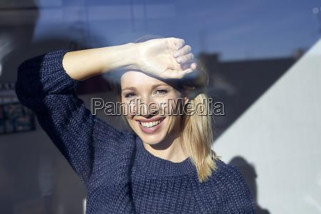 portrait of happy blond woman looking