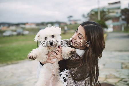 young, woman, holding, cute, white, dog - 26391774