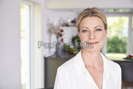portrait of confident woman at home