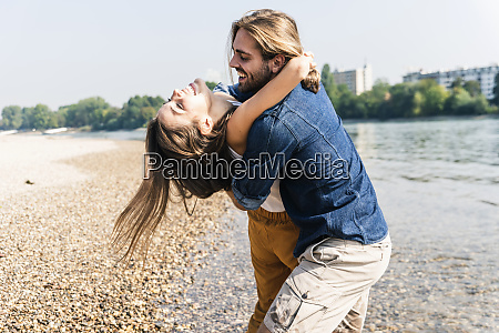 happy young couple in love embracing