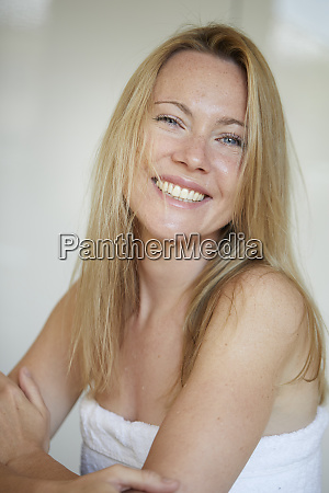 portrait of a smiling woman wrapped