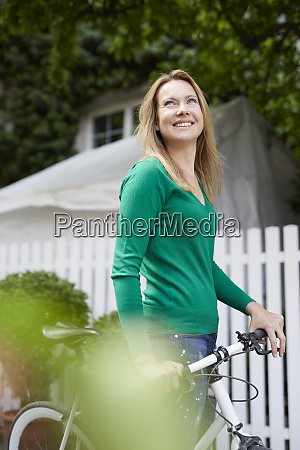 young woman with bicycle in the