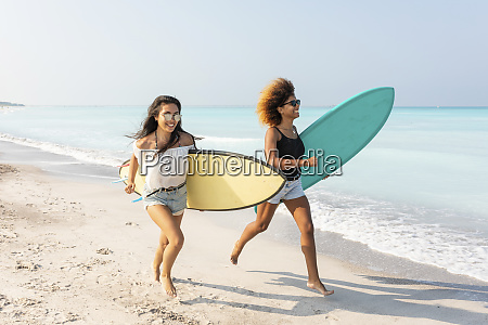 girl friends running on the beach