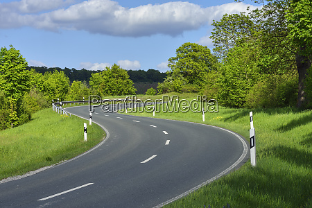 winding road in the countryside bavaria