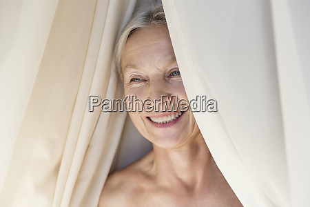 portrait of relaxed senior woman behind