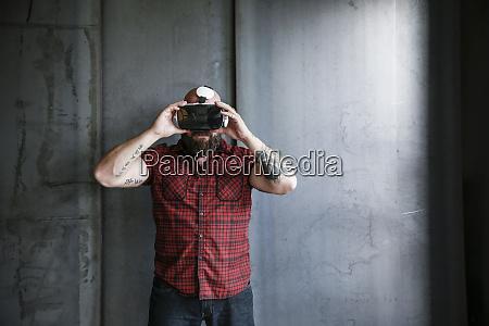 bearded man wearing vr glasses