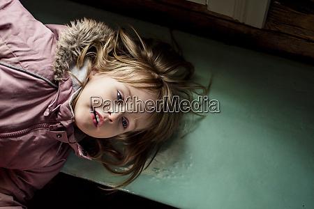 portrait of little girl lying on