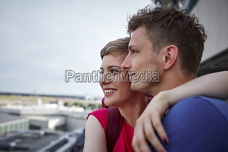 happy couple on observation deck at