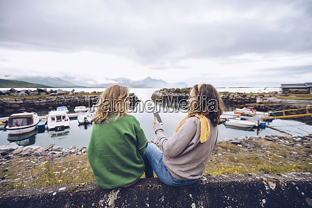 norway senja two young woman sitting