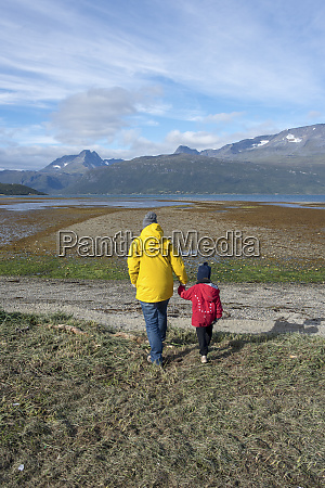 norway mother and daughter walking to