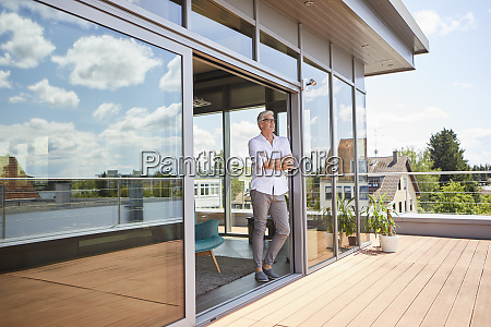 mature man relaxing standing at roof