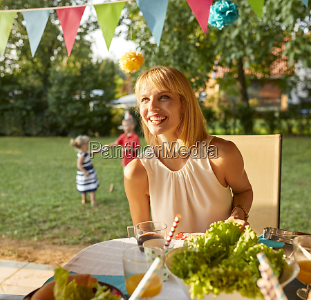 happy woman on a garden party