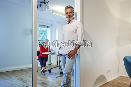 portrait of mature man leaning against