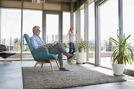 mature couple relaxing at home using