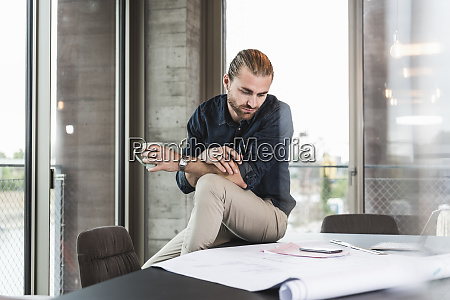 young businessman looking at plan on