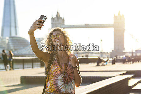 uk london smiling young woman taking