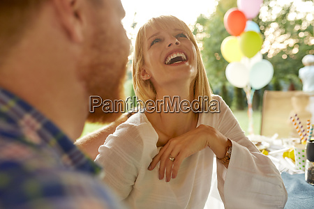 laughing woman with man on a