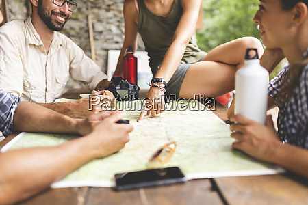group of hikers sitting together planning