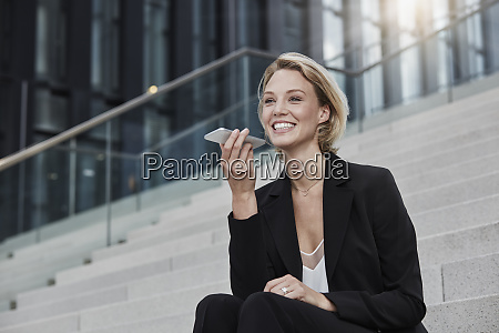 portrait of smiling businesswoman sitting