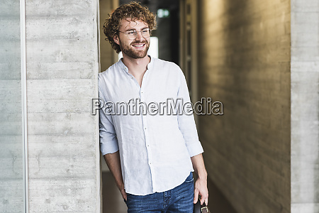 smiling casual young man standing on