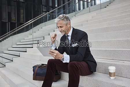 fashionable businessman with travelling bag nd