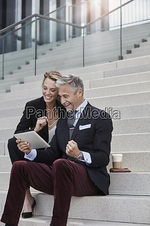 two business people sitting together on
