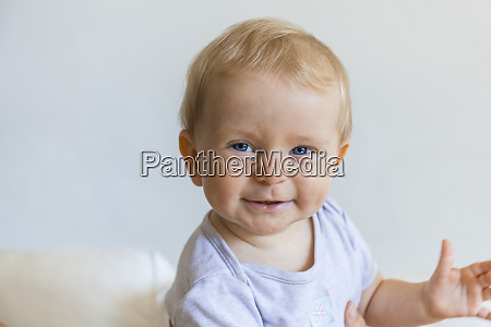 portrait of happy blond baby girl