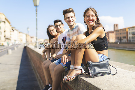 italy pisa group of four happy