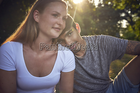 romantic young couple sitting in park