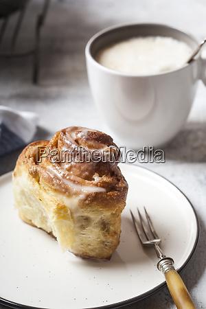 home baked cinnamon bun with icing
