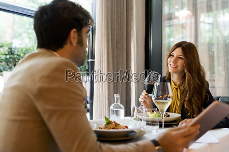 smiling woman with glass of red
