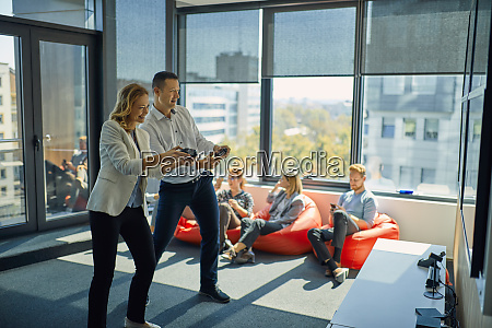 colleagues playing video game in office