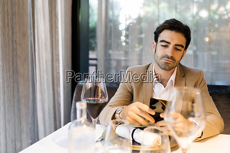 man sitting at table in a
