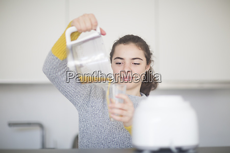 portrait of smiling woman pouring freshly