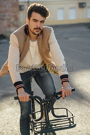 portrait of young man riding commuter