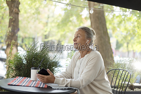 senior woman at an outdoor cafe