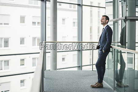 successful businessman standing in office building