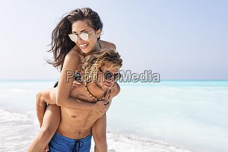 happy couple on gthe beach man